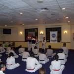 Grandmaster Hae-man Park presents awards to students of Eastern Suburbs Taekwondo Sydney Australia.